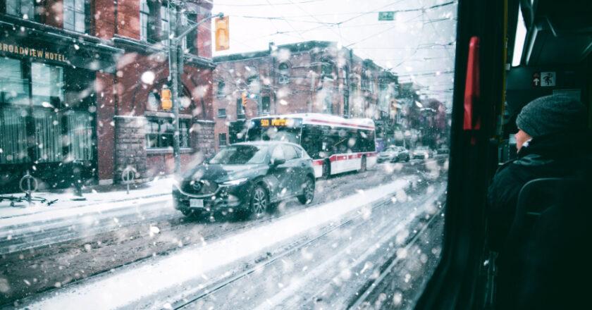 Car in Snowy Winter Day