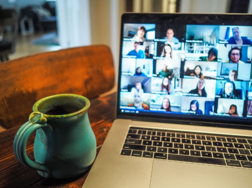 Zoom meeting on laptop with cup of coffee