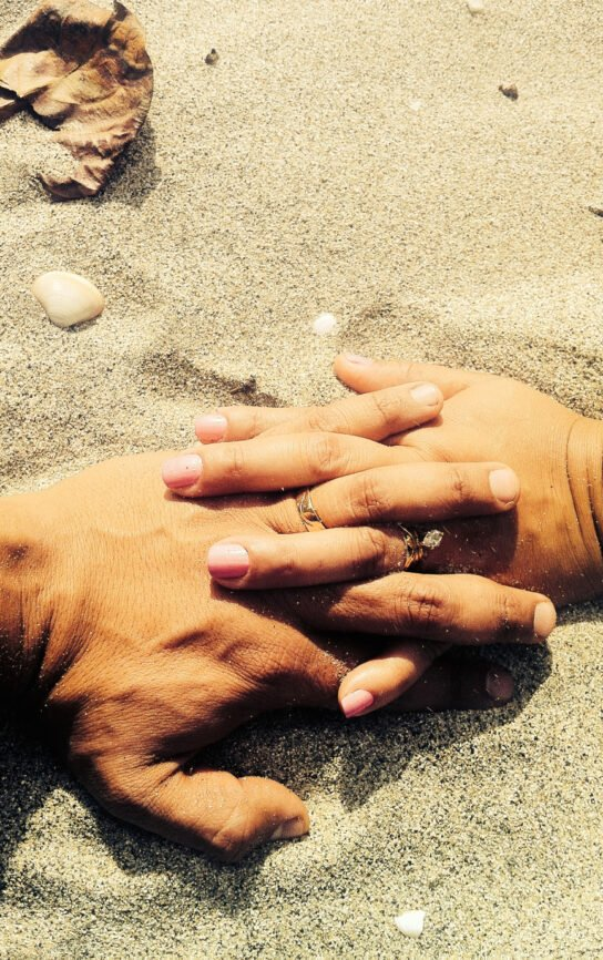 Man and woman Interlaced fingers on the sand