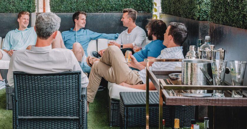 Men. sitting around networking