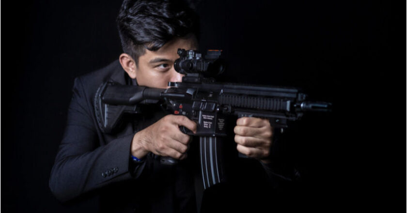 Man aiming rifle with night vision