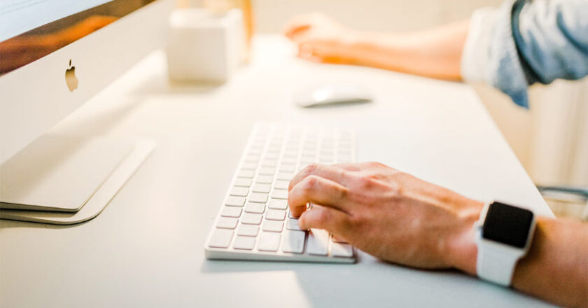 Man in front of computer typing