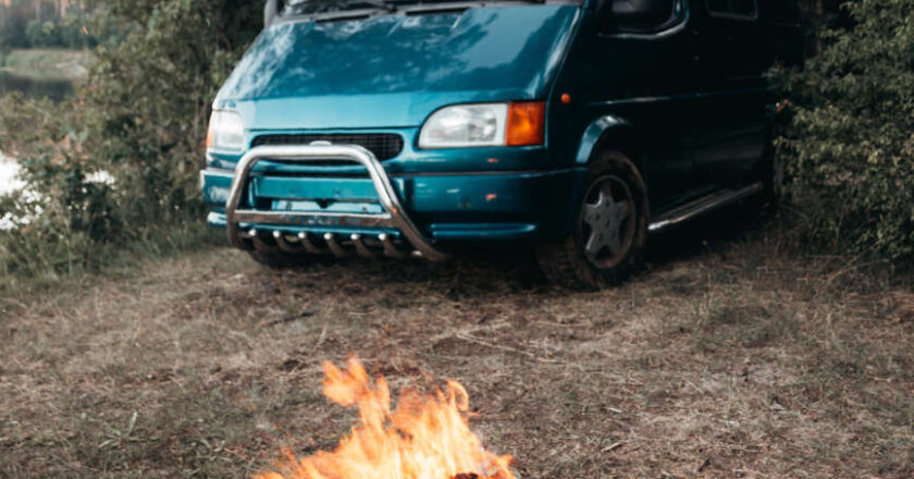 Blue Ford van at campsite