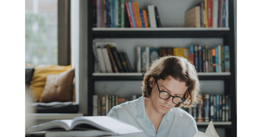 College Student studing with many books on desk