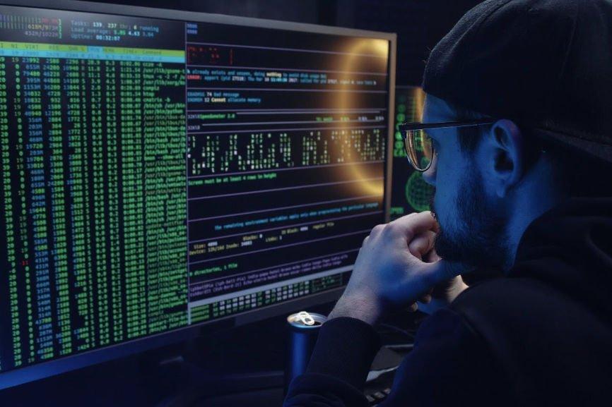 Man in front of dark computer screen