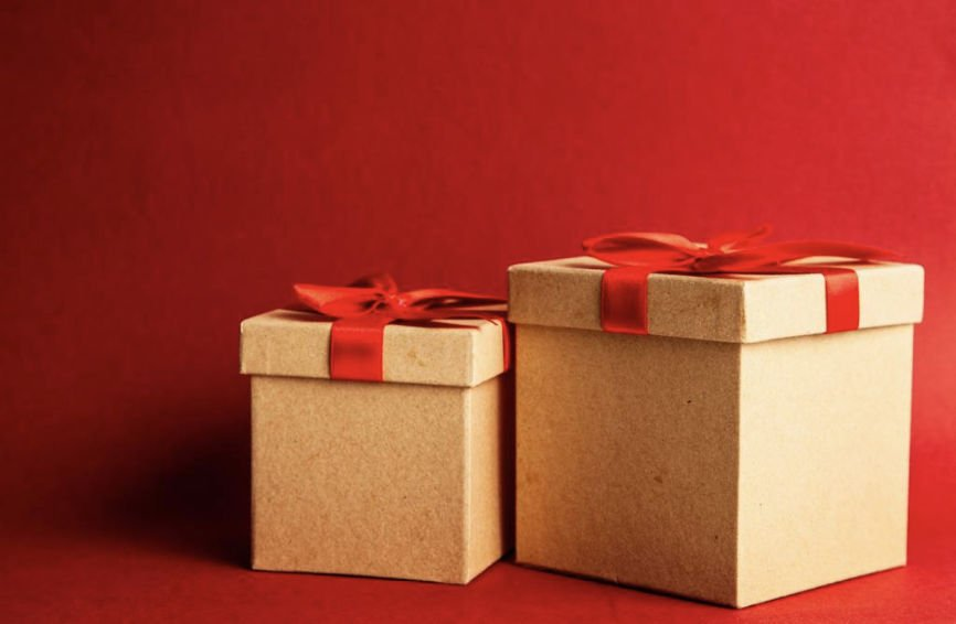 Two gift boxes on a red background