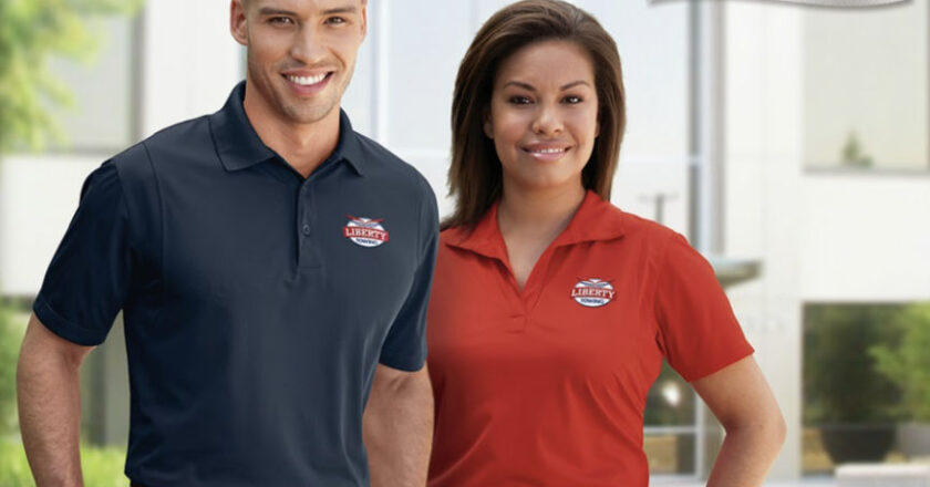 Man and Woman in company uniforms