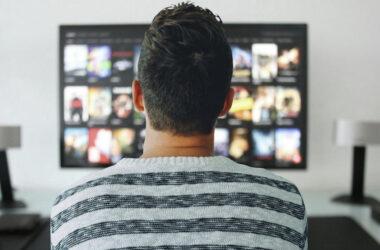 Man watching Movies on TV