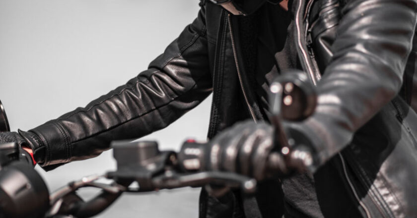 Man on motorcycle wearing a leather jacket