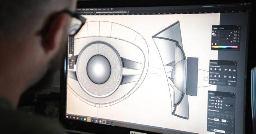 Man looking at computer screen displaying a CAD Drawing