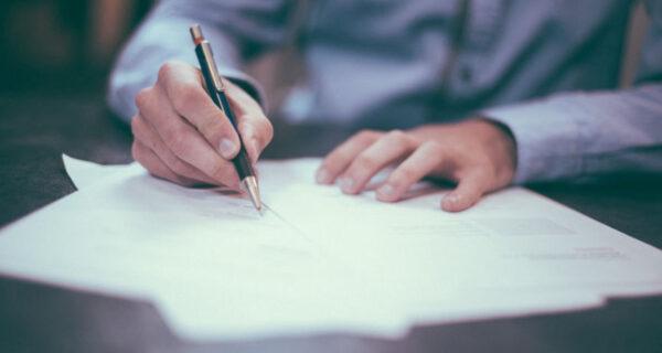 Man writing an estate plan