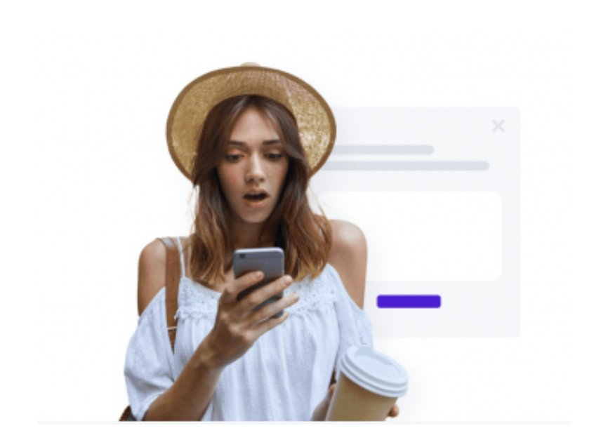 Young lady looking surprised at her phone