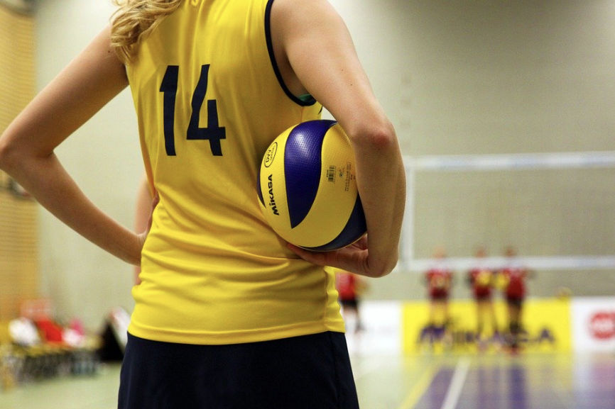 Woman volleyball player holding a volleyball