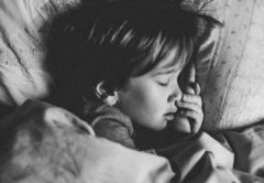 Child sleeping in toddler bed