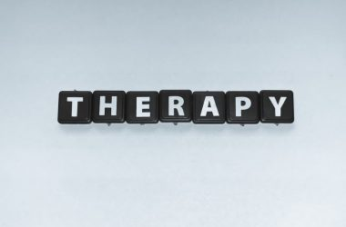 Image of the word Therapy spelled out on black tiles